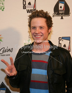 Ashton Holmes arrives at the 7th Annual World Poker Invitational on February 28, 2009 at the Commerce Casino, in Commerce, CA.