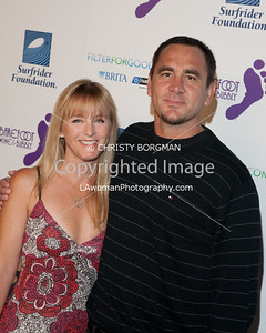 "Jim Lindberg and his wife arrive at the Surfrider Foundation's 25th Anniversary Gala on Ocotber 9, 2009 at the California Science Center's Wallis Annenberg Building.  He fronted the punk band Pennywise.  He also wrote a book called ""Punk Rock Dad""."
