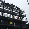 Installing video board panels, March 31 (David S. Glasier - The News-Herald)