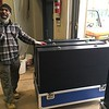 RWA instaler Andrew Woodlin, standing next to three of the new video board's 84 panels, March 28  (David S. Glasier - The News-Herald)