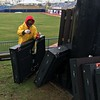 RWA's Andrew Woodlin preparing a panel for lifting to video board (David S. Glasier - The News-Herald)
