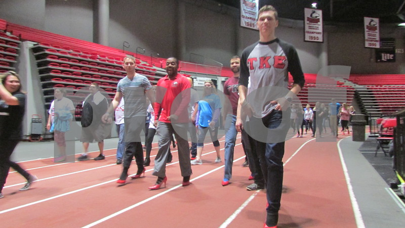 NIU students walk Saturday morning as part of Walk a Mile in Her Shoes at the Northern Illinois University Convocation Center.