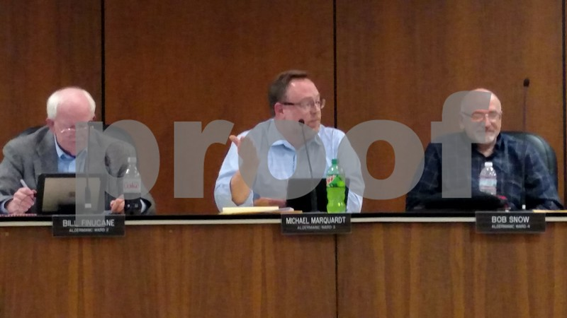 Ward 3 Alderman Michael Marquardt (center), alongside Ward 2 Alderman Bill Finucane (left) and Ward 4 Alderman Bob Snow, discusses a proposed ordinance limiting video gaming establishments during the DeKalb City Council meeting Monday.
