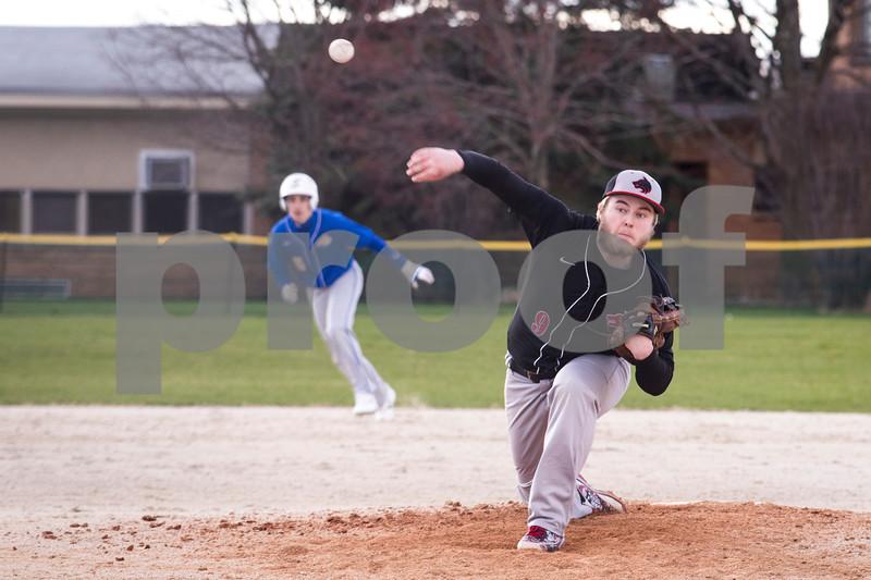 Sam Buckner for Shaw Media.<br /> Jordan Morris pitches the ball with runners on base on Thursday April 6, 2017.