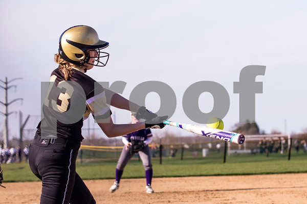 Sam Buckner for Shaw Media.<br /> Hannah Mizgalski makes contact with the ball on Friday April 7, 2017 against Rochelle.