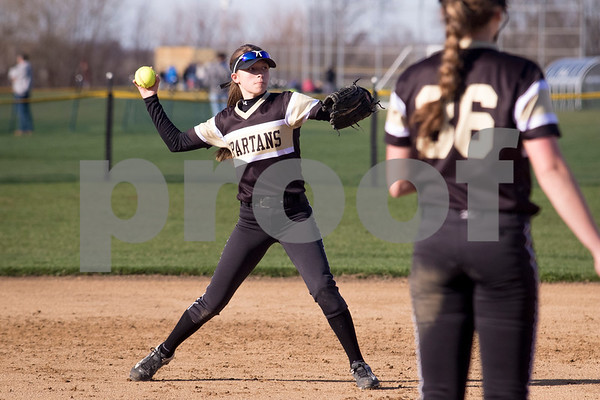 Sam Buckner for Shaw Media.<br /> Mya Lee fields a ground ball and throws it to first base on Friday April 7, 2017.