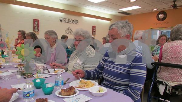 Volunteers Jere Tulk (from left), June Tritt and Kay Billings enjoy brunch