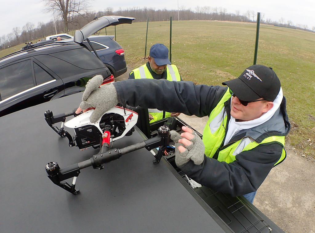 . Jonathan Tressler � The News-Herald <br> Willoughby Fire Department Capt. Scott Mlakar readies an unmanned aerial system, or drone, April 11 during a training exercise at the Geauga County Fairgrounds, part of a weeklong Drone Academy program offered for public safety professionals through Cuyahoga Community College.