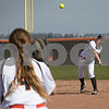 Sam Buckner for Shaw Media.<br /> Mackenzie Riggs fields a ball and throws it to Jenna Levine on Saturday April 15, 2017.