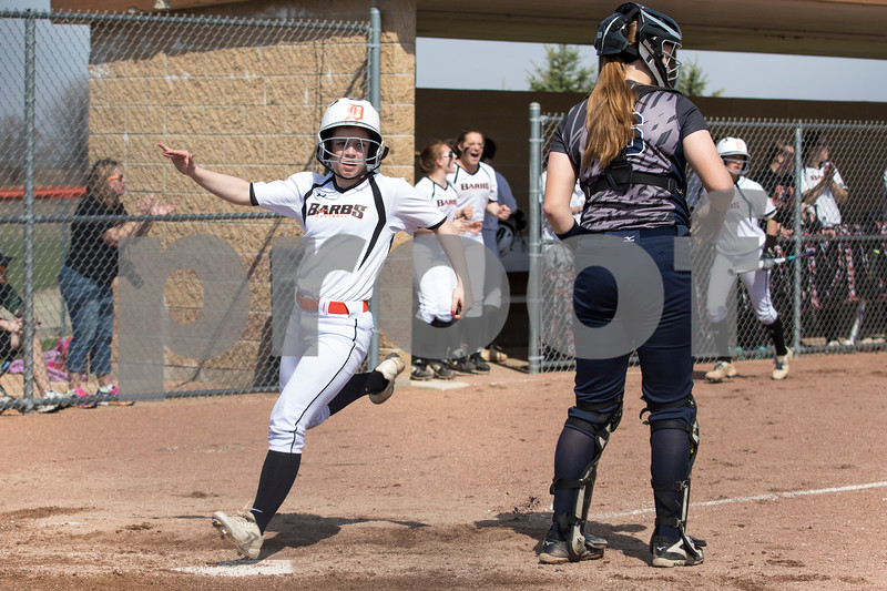Sam Buckner for Shaw Media.<br /> Payton Montgomery scores on a double hit by Taiylor Karasewski on Saturday April 15, 2017.