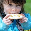 Helen O'Bryan, 3, Willoughby enjoys a Smiley Cookie at the Easter Monday Egg Roll at the James A. Garfield Historic Site.<br /> Kristi Garabrandt - The News-Herald