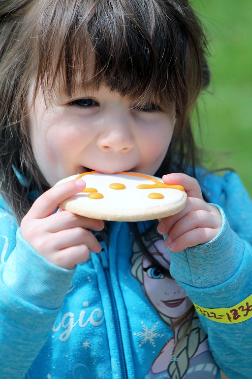 . Helen O\'Bryan, 3, Willoughby enjoys a Smiley Cookie at the Easter Monday Egg Roll at the James A. Garfield Historic Site. Kristi Garabrandt - The News-Herald