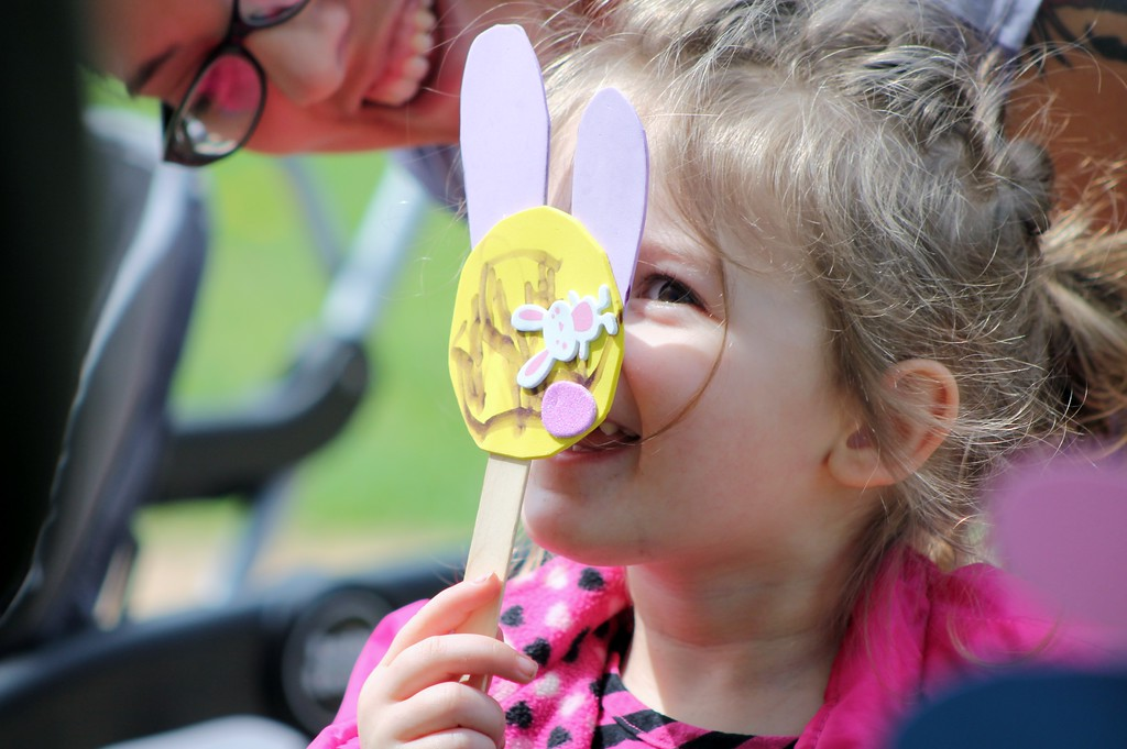 . Addison Duraney, 2, Mentor shows off the bunny craft she made at the Easter Monday event  Kristi Garabrandt - The News-Herald