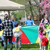 Volunteers at the Easter Monday event at the James A. Garfield Historic Site in Mentor play with kids using a parachute and Plastic eggs.<br /> Kristi Garabrandt - The News-Herald