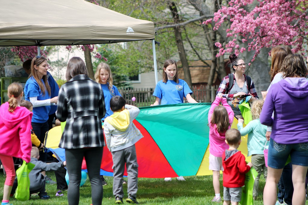 . Volunteers at the Easter Monday event at the James A. Garfield Historic Site in Mentor play with kids using a parachute and Plastic eggs. Kristi Garabrandt - The News-Herald