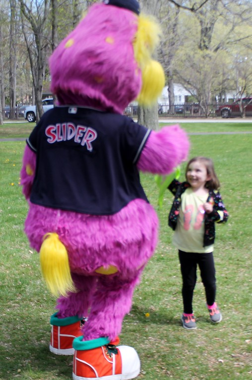 . Estella Schmidt, 5, of Eastlake dances with Slider, the mascot of the Cleveland Indians during the Easter Monday egg roll event. Kristi Garabrandt -The News-Herald