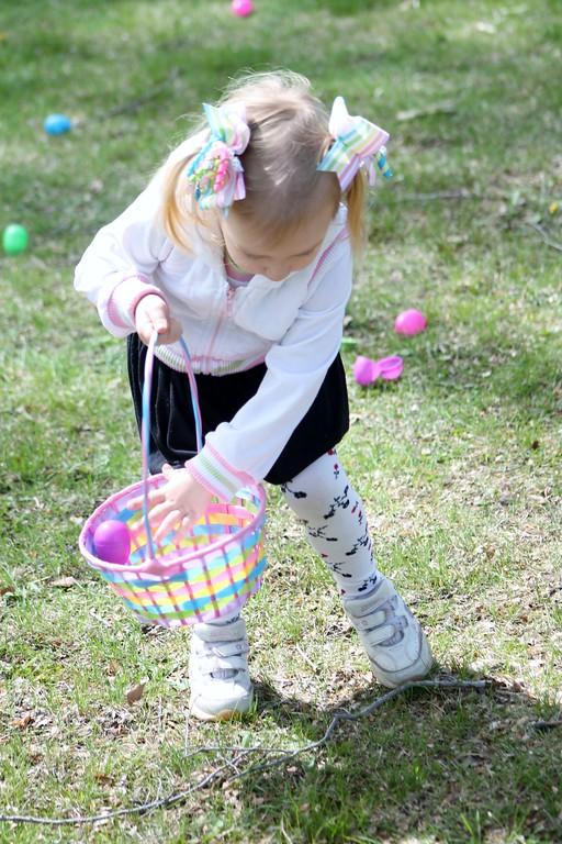 . Maria Taraska, 4, Mentor participates in the toddler Easter egg hunt during the Easter Monday event. Kristi Garabrandt
