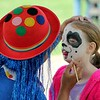 Ava Stockmaster, 8, Willoughby gets her face painted by Diamonds the Magical Clown.<br /> Kristi Garabrandt - The News-Herald