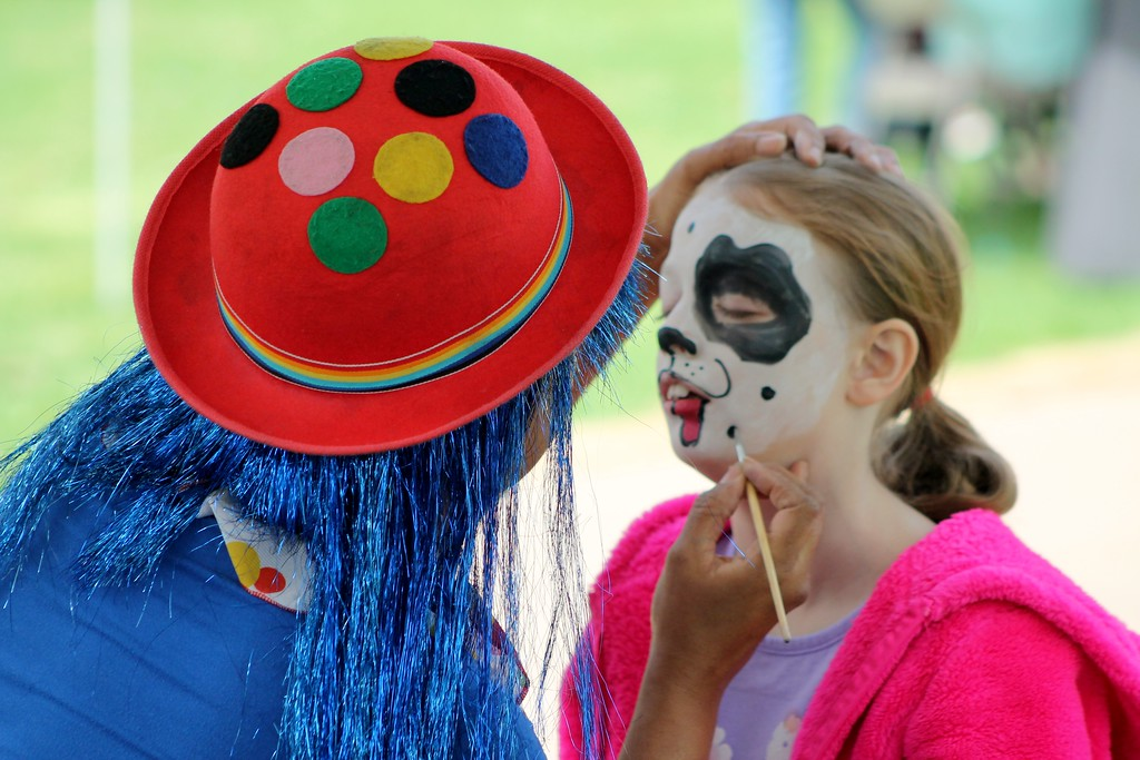 . Ava Stockmaster, 8, Willoughby gets her face painted by Diamonds the Magical Clown. Kristi Garabrandt - The News-Herald