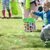 Ryan Welker, 4, Highland Heights races to gather eggs during the egg hunt at the Easter Monday event.<br /> Kristi Garabrandt - The News-Herald