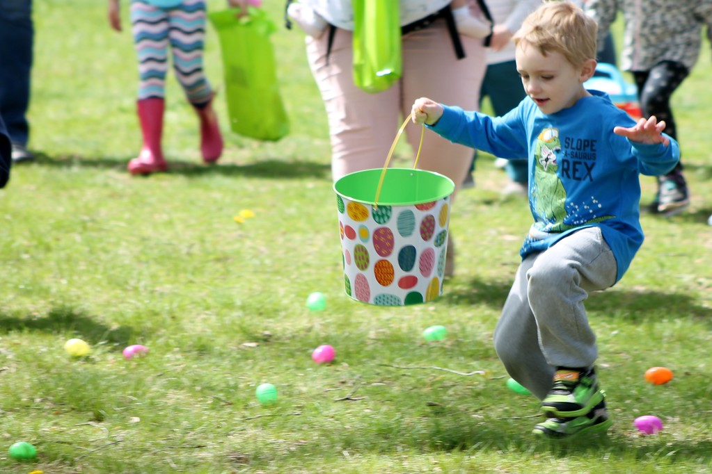 . Ryan Welker, 4, Highland Heights races to gather eggs during the egg hunt at the Easter Monday event. Kristi Garabrandt - The News-Herald