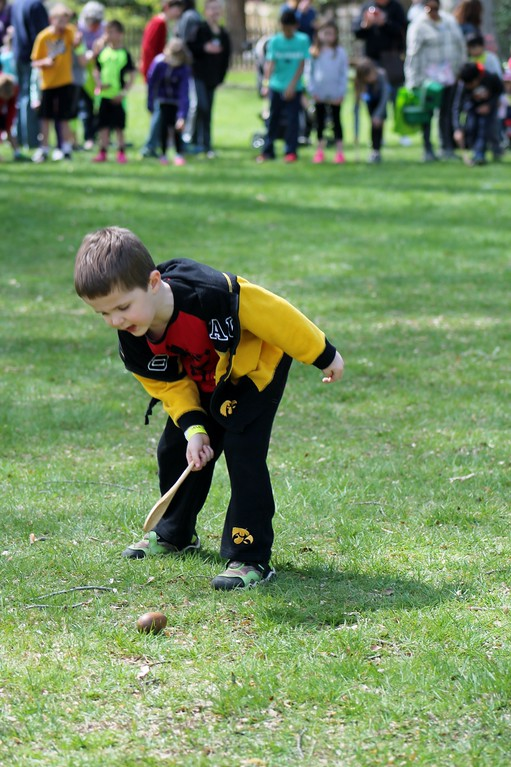 . Colin Woulff, 4, Mentor,  was determined to get his egg across the finish line line the egg roll event on Easter Monday. Kristi Garabrandt - The News-Herald