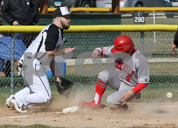 dc.sports.0420.sycamore yorkville baseball02