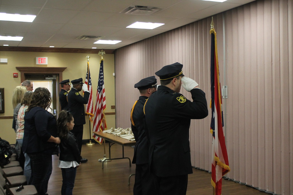 . Kristi Garabrandt � The News-Herald <br> Willoughby Police Department Honor Guard salutes the colors at the beginning of the  dedication ceremony for fallen officer Jason Gresko  at Willoughby City Hall on April 20, 2018.