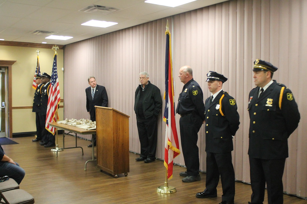 . Kristi Garabrandt � The News-Herald <br> State Rep. John Rogers, former Willoughby Mayor David Anderson and and Willoughby Police chief Jack Beckwith stand with the Willoughby Police Department Honor Guard at the end of the  dedication ceremony for fallen officer Jason Gresko  at Willoughby City Hall on April 20, 2018/