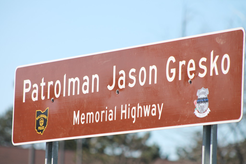 . Kristi Garabrandt � The News-Herald <br> Two signs placed on Route 91 in Willoughby to honor fallen officer Jason Gresko,  were simultaneously unveiled on April 20, 2018.