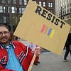 Rhil with sign, back  (David S. Glasier - The News-Herald)
