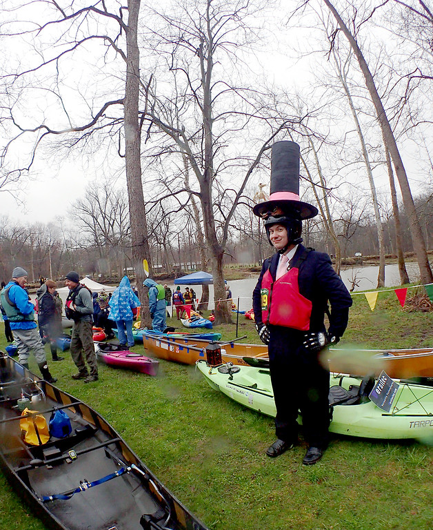 . Jonathan Tressler � The News-Herald <br> Madison Township resident Dave Birch stands proudly beneath his gargantuan top hat minutes before getting underway in the 2018 Grand River Canoe and Kayak Race near the covered bridge in Ashtabula County�s Harpersfiled Township April 28.