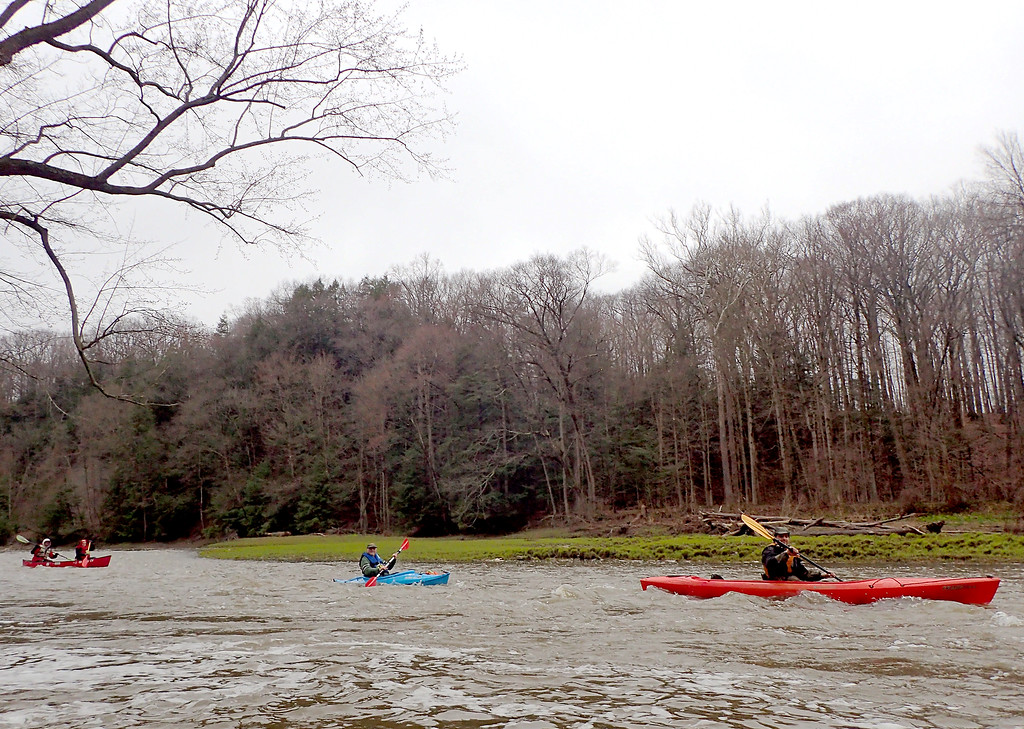 . Jonathan Tressler � The News-Herald <br>Two kayaks and a canoe cruise past the author along a series of mild rapids about half-way through the roughly 8 1/2-mile Grand River Canoe and Kayak Race April 28.