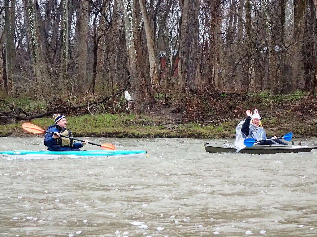 . Jonathan Tressler � The News-Herald <br> A participant in the 2018 Grand River Canoe and Kayak Race smiles for the camera April 28 about a helf-mile or so downstream from the roughly 8 1/2-mile paddle from the Harpersfield Covered Bridge in western Ashtabula County to Hidden Valley Park just downstream form the ohio Route 528 bridge in Madison Township.