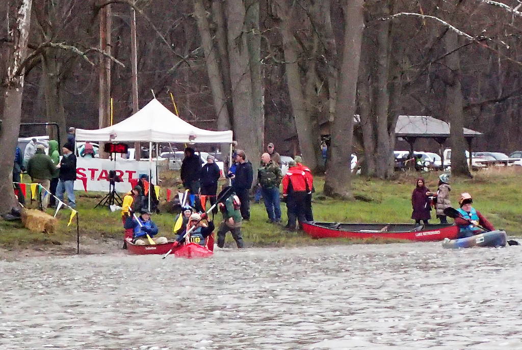 . Jonathan Tressler � The News-Herald <br> Paddlers sporting all manner of mad hats shove off from the starting point of the 2018 Grand River Canoe and Kayak Race just downstream from the Harpersifeild Covered Bridge in Ashtabula County on April 28.