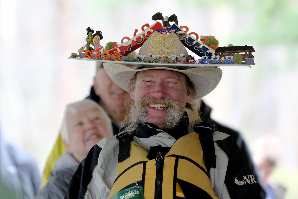 . Jonathan Tressler � The News-Herald <br> Erie Pa. resident and two-time winner of the Grand River Canoe and Kayak race�s maddest hat contest grins after the winning announcement as he sports his elaborate lid: an homage to the 50th anniversary of the Wild and Scenic RIvers Act.