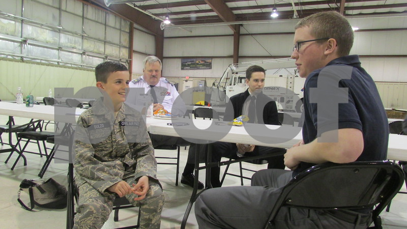Civil Air Patrol Cadet Travis Dulzo, 12, talks with senior member Patrick Kozlowski, 20, during an open house Saturday at the DeKalb Taylor Municipal Airport. The Civil Air Patrol, which formed in January, is trying to recruit new members.