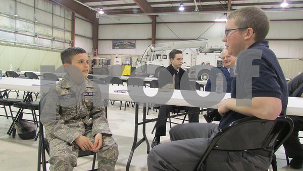 CAP Cadet Travis Dulzo, 12, talks with CAP senior member Patrick Kozlowski, 20, at the DeKalb Taylor Municipal Airport
