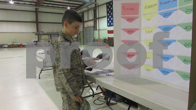Travis Dulzo plays a game at the Civil Air Patrol open house Saturday at DeKalb Taylor Municipal Airport.