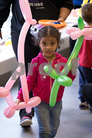 Sam Buckner for Shaw Media.<br /> A girl walks away with her balloon dog and flower on Saturday April 29, 2017 at the YMCA Healthy Kids Day.