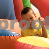 Sam Buckner for Shaw Media.<br /> A boy races through an inflatable obstacle cource on Saturday April 29, 2017 at the YMCA Healthy Kids Day.