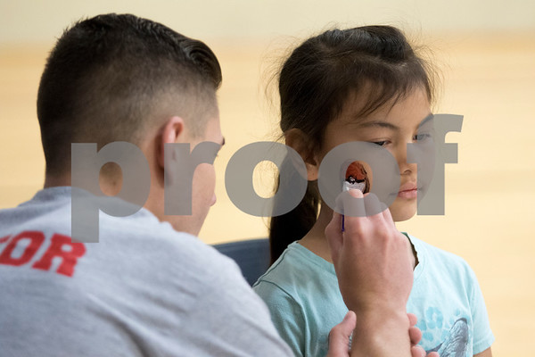 Sam Buckner for Shaw Media.<br /> A girl gets a pokeball painted on her face at the YMCA Healthy Kids day on Saturday April 29, 2017.