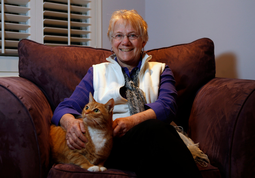 . Bonne Goltz Reiser poses for a picture in her home with Milo, one of her two cats, in El Cerrito, Calif., on Monday, March 3, 2014.  (Nhat V. Meyer/Bay Area News Group)