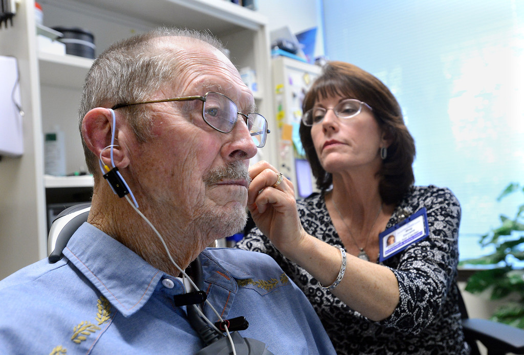 . Marvin Johnson, 90, of Walnut Creek, has the electronic response of his new hearing aids verified by Supervisor Audiologist Meg Devane at the Kaiser Permanente Hearing Aid Center in Walnut Creek, Calif., on Tuesday, March 4, 2014. Hearing loss is a part of aging, but practical steps can be taken to slow the process. Technology can help doctors treat hearing loss both with high-tech hearing aids and in some cases, surgery.  (Dan Honda/Bay Area News Group)