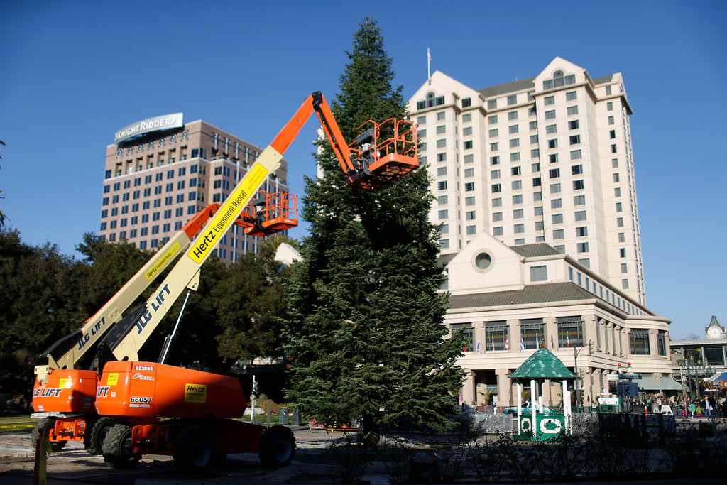 . The Christmas tree decorations have been removed, and a bare tree and lift equipment are in place during cleanup at  Christmas in the Park, in downtown San Jose, Calif., on Saturday, Jan. 4, 2014. (Josie Lepe/Bay Area News Group)