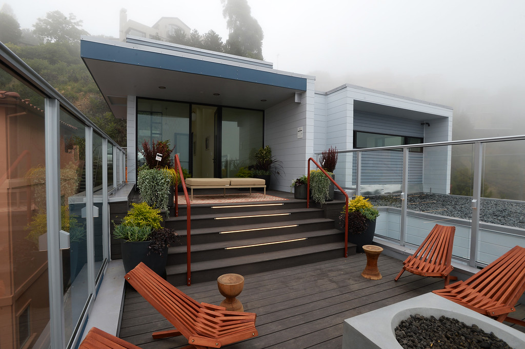 . Perched on a hillside, this Sunset\'s 2016 Idea House features many outdoor terraces this with one with a fire pit in Berkeley, Calif., on Monday, Aug 22, 2016.  (Susan Tripp Pollard/Bay Area News Group) .