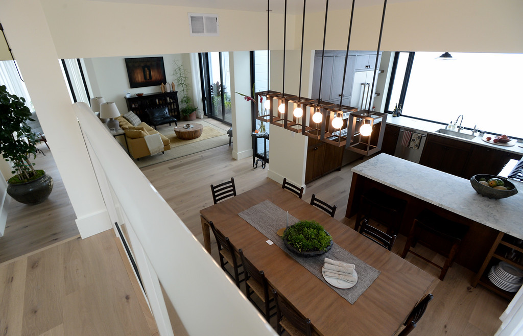 . Pendant lights clustered together serve as a chandelier in the dining room of this Sunset\'s 2016 Idea House which features French oak wood floors throughout in Berkeley, Calif., on Monday, Aug 22, 2016.  (Susan Tripp Pollard/Bay Area News Group)