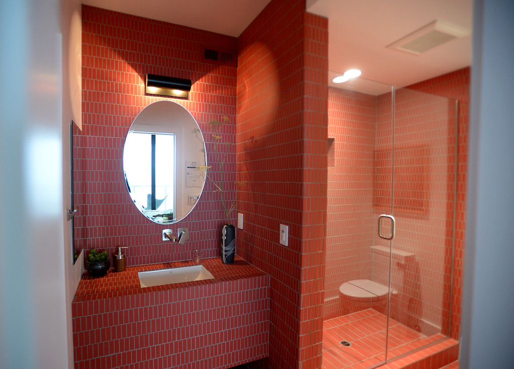 . Paprika colored tile adds a warm touch to the guest bath of this Sunset Magazine\'s 2016 Idea House in Berkeley, Calif., on Monday, Aug 22, 2016.  (Susan Tripp Pollard/Bay Area News Group)