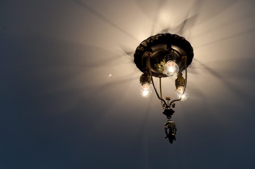 . An antique ceiling light is featured in the master bedroom of this Sunset\'s 2016 Idea House in Berkeley, Calif., on Monday, Aug 22, 2016.  (Susan Tripp Pollard/Bay Area News Group)