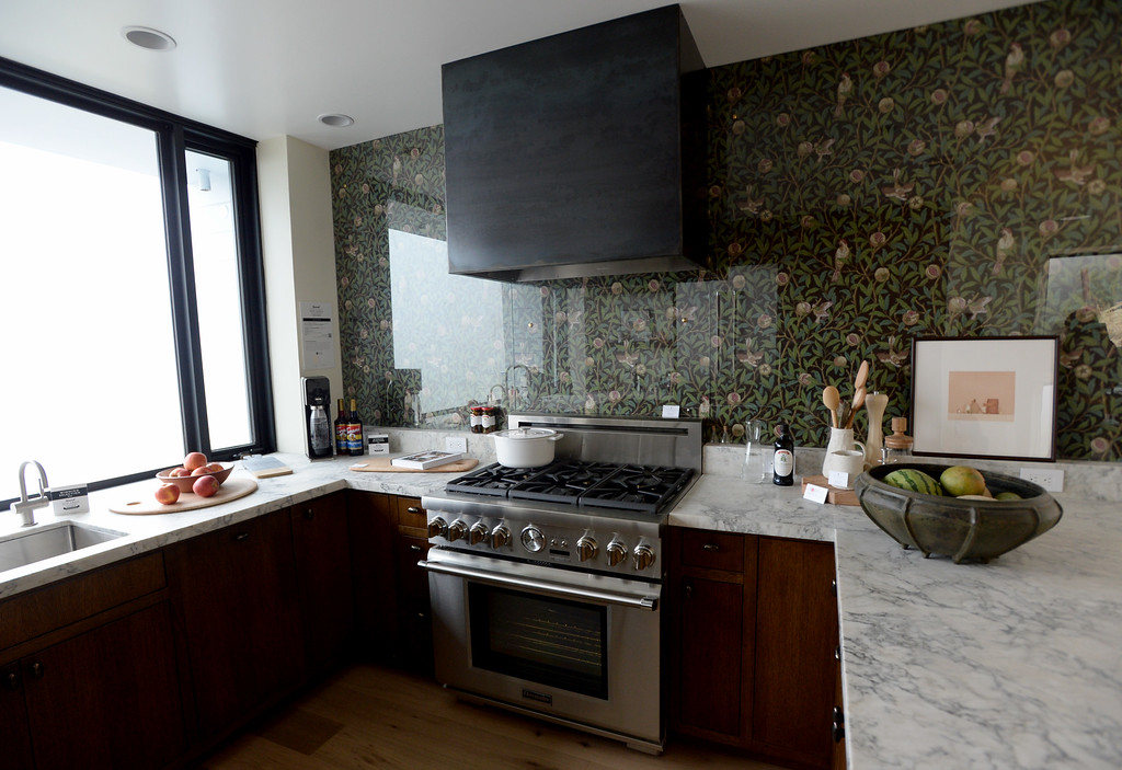 . Marble countertops and bird and pomegranate wallpaper in charcoal and sage by William Morris are featured in the kitchen of this Sunset\'s 2016 Idea House in Berkeley, Calif., on Monday, Aug 22, 2016.  (Susan Tripp Pollard/Bay Area News Group)